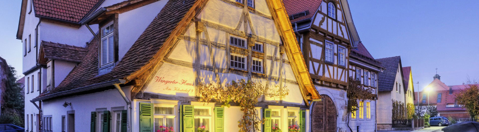 Small half-timbered house with facade lighting